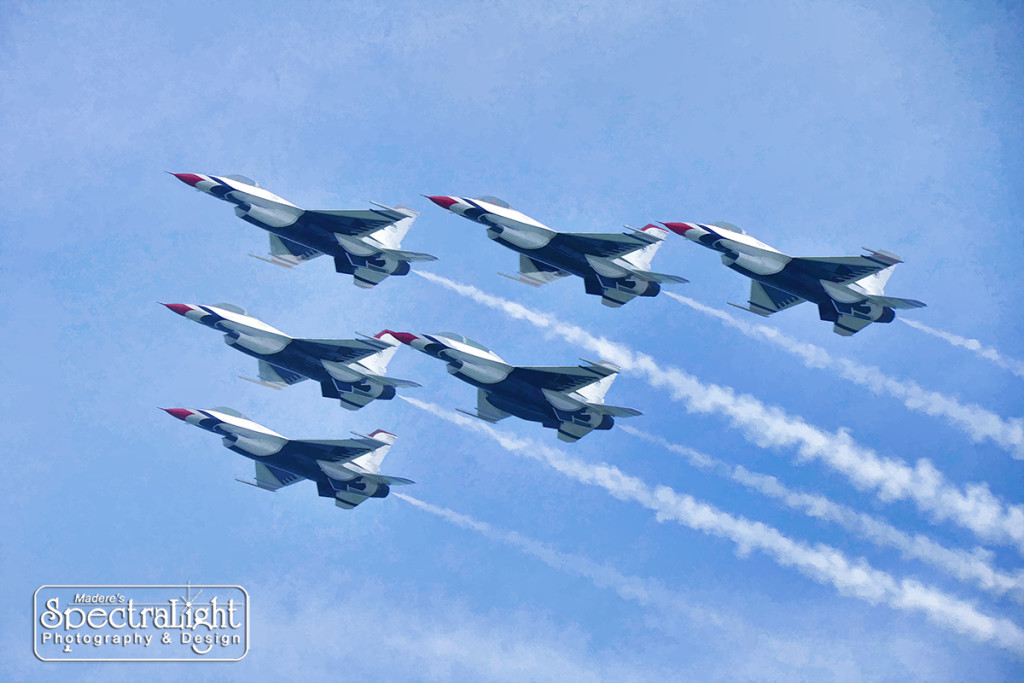 During the 2015 Cleveland National Air Show - the U.S. Air Force Thunderbirds fly over the William G. Mather steamship docked at the Great Lakes Science Center.